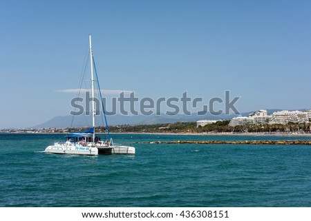 MARBELLA, ANDALUCIA/SPAIN - MAY 26 : Catamaran Entering the Harbour in Marbella Spain on May 26, 2016. Unidentified people