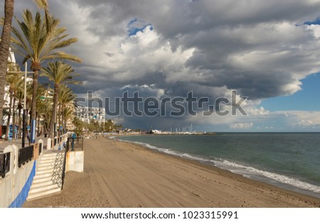 MARBELLA, ANDALUSIA, SPAIN - FEBRUARY 6, 2018: Beach, sea and clouds on the sea front