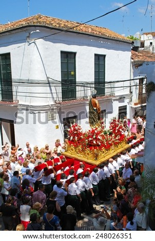 MARBELLA, SPAIN - JUNE 11, 2008 - Bearers carrying a Statue of Saint Bernard on a float through the town streets during the Romeria San Bernabe, Marbella, Andalusia, Spain, June 11, 2008. - stock photo