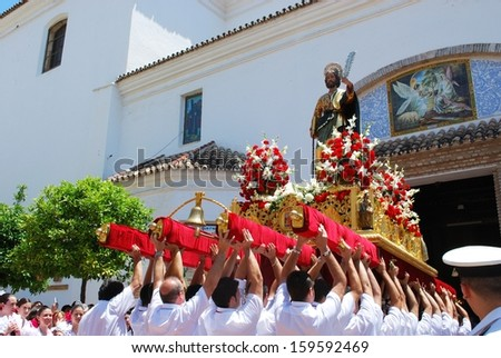 MARBELLA, SPAIN - JUNE 11, 2008 - Carrying the float (paso) into the church at the Romeria San Bernabe religious festival, Marbella, June 11, 2008. - stock photo
