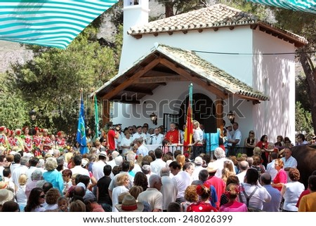 MARBELLA, SPAIN - JUNE 8, 2008 - Priest giving sermon in the Hermitage during the Romeria San Bernabe procession, Marbella, Costa del Sol, Andalusia, Spain, Western Europe, June 8, 2008. - stock photo