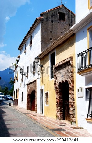 MARBELLA, SPAIN - JUNE 12, 2008 - Traditional Spanish buildings along an old town street, Marbella, Costa del Sol, Malaga Province, Andalusia, Spain, Western Europe, June 12, 2008. - stock photo