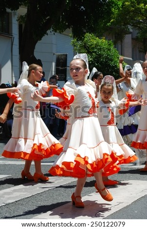 MARBELLA, SPAIN - JUNE 11, 2008 - Young flamenco dancers dancing in the street during the Romeria San Bernabe, Marbella, Costa del Sol, Malaga Province, Andalusia, Spain, Western Europe, June 11, 2008 - stock photo