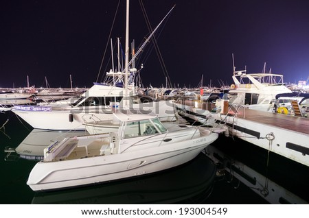 MARBELLA, SPAIN - MAY 1: Puerto Banus on May 1, 2014 in Marbella,Spain. Is a marina complex, located in Costa del Sol. contains luxury shops and is also scene for luxury cars owned by celebrities. - stock photo