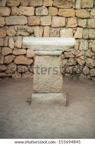 Marble ancient altar in the old temple. Stone altar for performing rituals in ancient religion. - stock photo