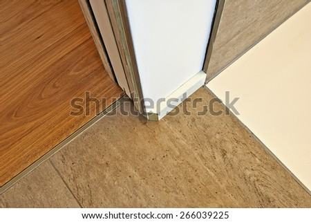 Marble and hardwood floor between door and before finition - stock photo