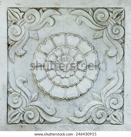 Marble architectural detail showing scrollwork and chrysanthemum flower on public building in Beijing, China