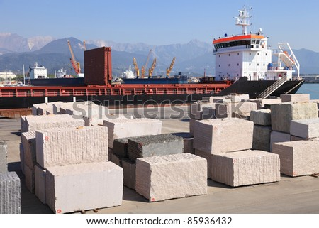 Marble blocks ready to load in Carrara harbor - stock photo