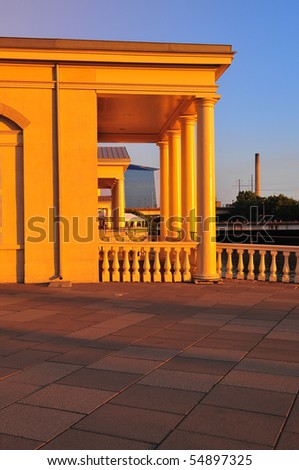 Marble building bathed in gold light at Philadelphia water works - stock photo