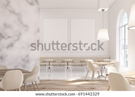 Marble Cafe Interior With White Walls, Large Windows, Beige Sofas And Chairs  And Square