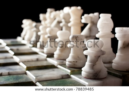 Marble chessboard formation on a black background
