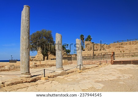 Marble column ruins in Caesarea Maritima National Park, a city and harbor built by Herod the Great about 25-13 BC. The archaeological ruins are on the Mediterranean coast of Israel. - stock photo