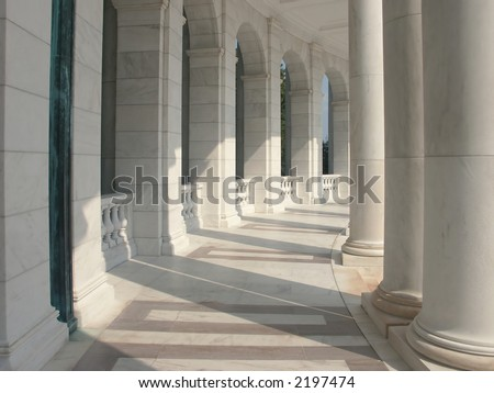 Marble Columns - a curved row of pillars joined with an elegantly carved baluster. - stock photo