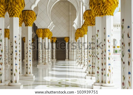 marble columns of the great mosque in Abu Dhabi - stock photo