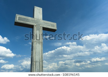 marble cross on the hill, blue sky and clouds, Budapest, Hungary - stock photo