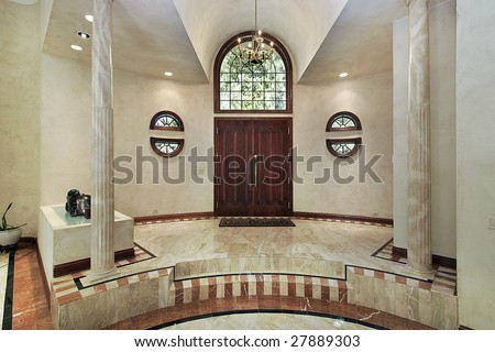 Marble foyer entryway with columns - stock photo