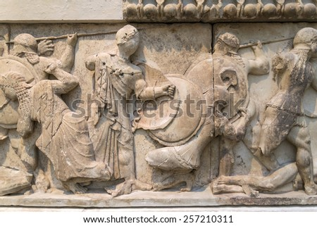 Marble frieze depicting the fight between Giants and lions along with Troy warriors - stock photo