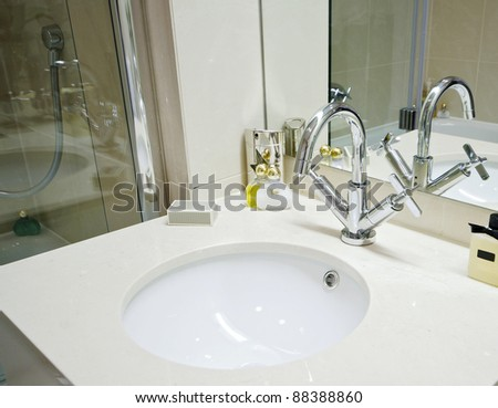 marble hand wash basin with luxury hygiene products - stock photo