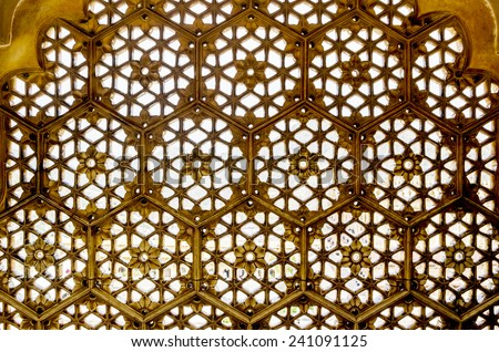 Marble lattice window carved in abstract design texture background