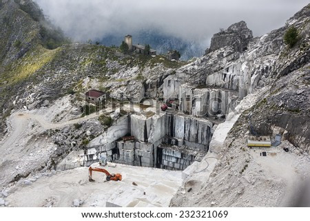 Marble mine on the top of the mountain in italy from birds eye view - stock photo