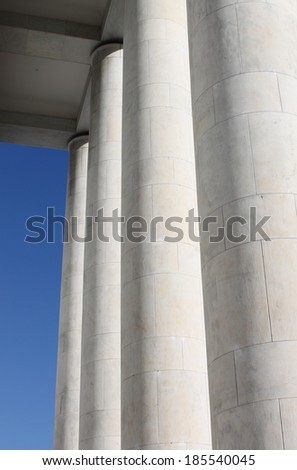 Marble modern columns on a blue sky background
