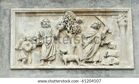 Marble panel in St Mark's basilica, Venice showing Abraham about to sacrifice his son Isaac, and the hand of god intervening. - stock photo