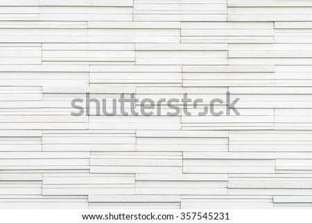 Marble rock tile wall w/ modern matte & polished detail patterned design interior decoration: Granite tiled detailed pattern texture background in natural light pastel white creme beige color tone  - stock photo