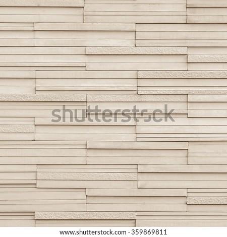Marble rock tile wall w/ modern matte & polished detail patterned design interior decoration: Granite tiled detailed pattern texture background in natural light pastel sepia creme beige color tone  - stock photo