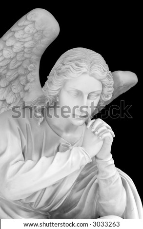 Marble sculpture of a guardian angel isolated on a black background - stock photo