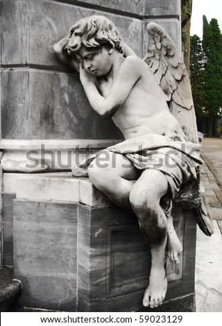 marble sculpture of angel at buenos aires cemetery - stock photo