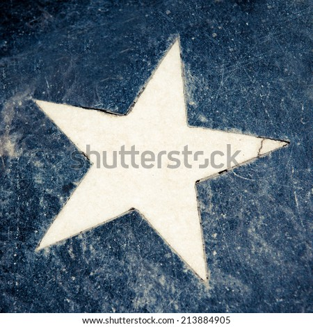 Marble star on a blue floor