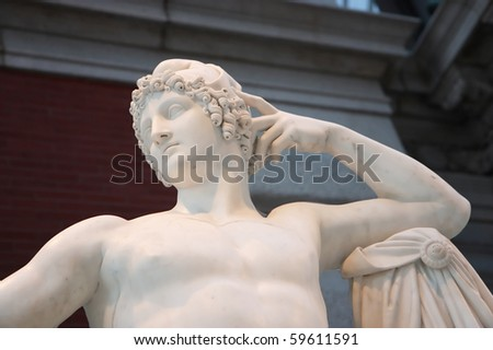 Marble statue of Greco-Roman man - stock photo
