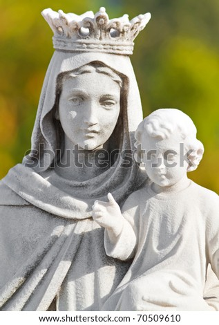 Marble statue of the Virgin and a child with a diffused green background - stock photo