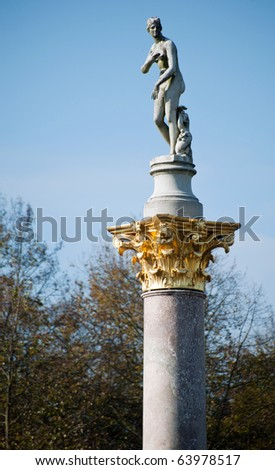Marble statue on column at Sanssouci park in Potsdam, Germany - stock photo
