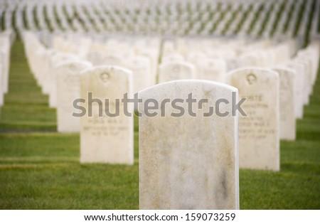 Marble Stone Military Headstones Hundreds Row Graveyard Cemetery - stock photo