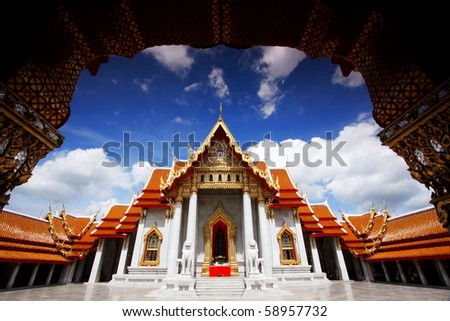 Marble Temple Under A Blue Sky in Bangkok - stock photo