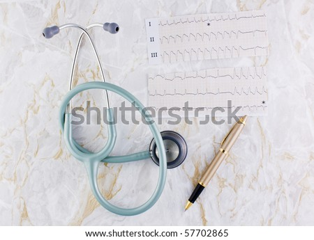 Marble texture background with stethoscope or  phonendoscope ECG electrocardiogram graph and elegant pen - stock photo