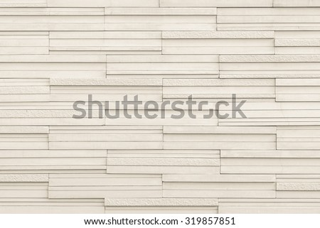 Marble tile wall texture detailed pattern background in light beige creamy creme brown color tone: Modern stone wall tiled patterned detail textured backdrop for interior design and decoration - stock photo