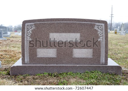 Marble tombstone with places to write two individuals' names and their common last name - stock photo