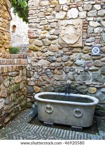 Marble tub in the Alcazaba of Malaga - stock photo