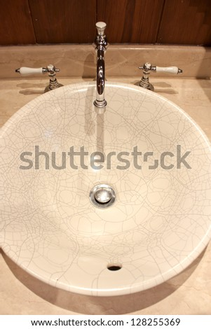 marble wash basin faucet sanitary cleaning brush. - stock photo