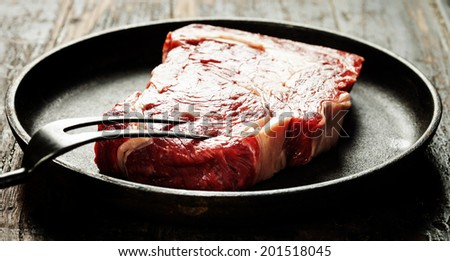 Marbled beef steak in a frying pan