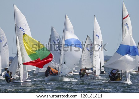 MARBLEHEAD, MA - JULY 25: Children race 420's during Junior Marblehead Race Week in Marblehead, MA on July 25, 2012. - stock photo