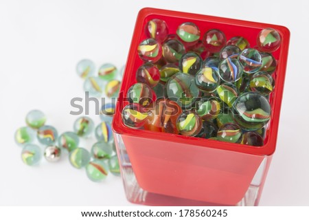 Marbles balls in red glass box. - stock photo