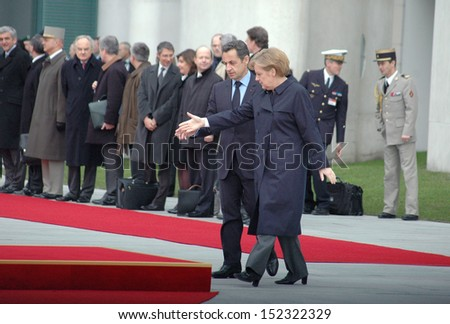 MARCH 12, 2009 - BERLIN: Nicolas Sarkozy, Angela Merkel during a reception with military honors at the Chanclery in Berlin.