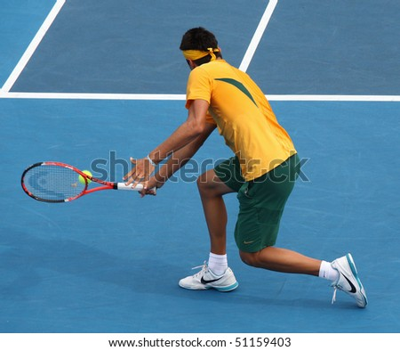 MARCH 7: Bernard Tomic of Australia in his win over Hsin-Han Lee of Chinese Taipei in their Davis Cup tie on March 7, 2010 in Melbourne, Australia - stock photo