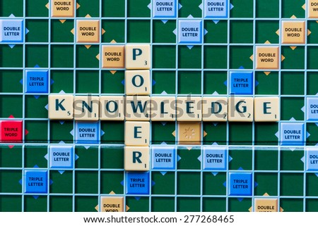 March 3, 2015 - Dhaka, Bangladesh - illustrative editorial of knowledge power Crossword on the colorful game board - stock photo