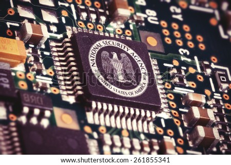 MARCH 16, 2015: Illustration of a spying CPU inside a computer with the NSA logo on it. - stock photo