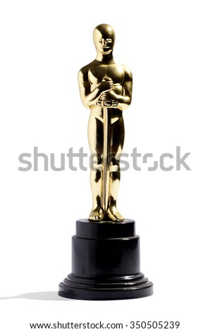 March 4, 2015  - Milan, Lombardy, Italy : Golden replica of an Oscar film award on a black plinth isolated on white in vertical format - stock photo