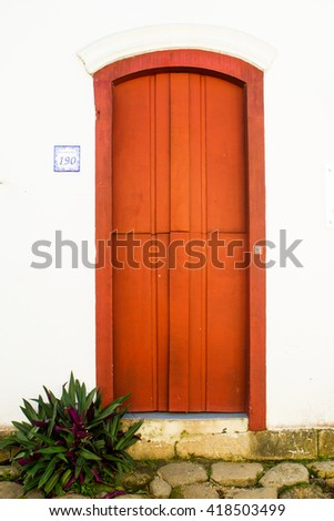 MARCH 27 - PARATY: Typical historical colourful wood doors in the colonial downtown of Paraty, Rio de Janeiro, Brazi on March 27, 2016 - stock photo